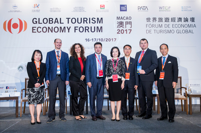 Group photo of Pansy Ho, Vice Chairman & Secretary-General, Global Tourism Economy Forum, and Speakers of the panel discussion