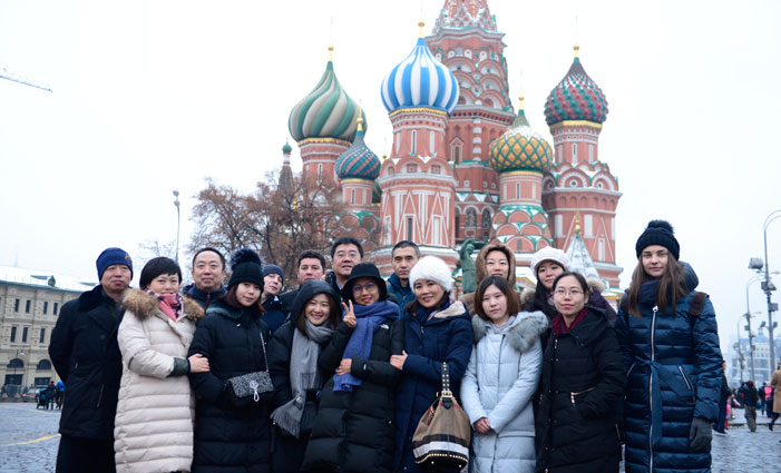 The survey group takes a photo in front of Saint Basil