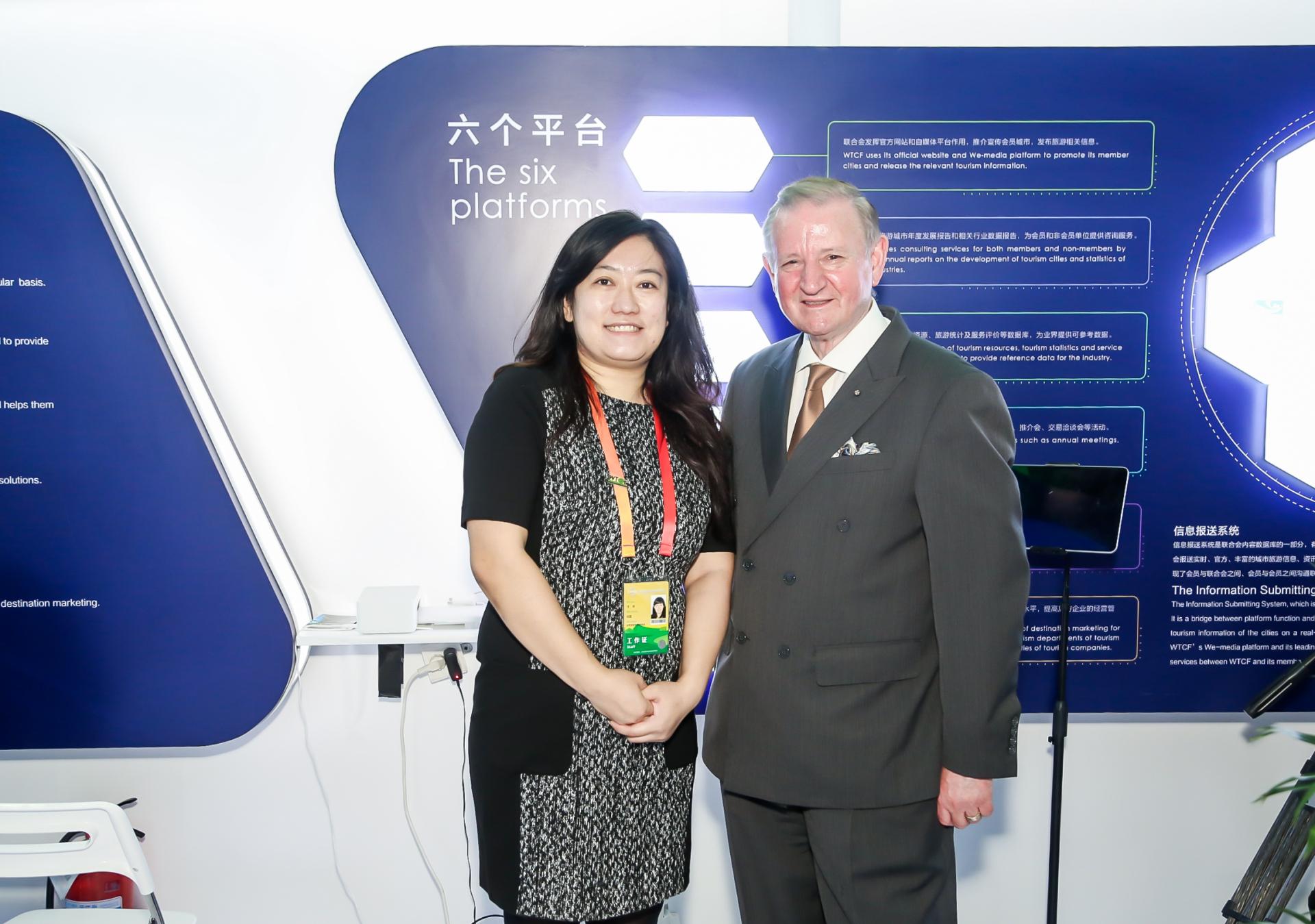 A photo of John Aquilina (right), Maltese Ambassador to China, taken at the booth of WTCF